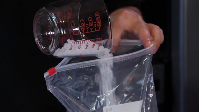 Add the rock salt to the ice.  Trust us - this is what makes it work!
