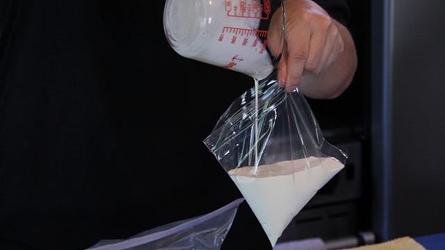 Pour your cream mixture into the plastic bag.