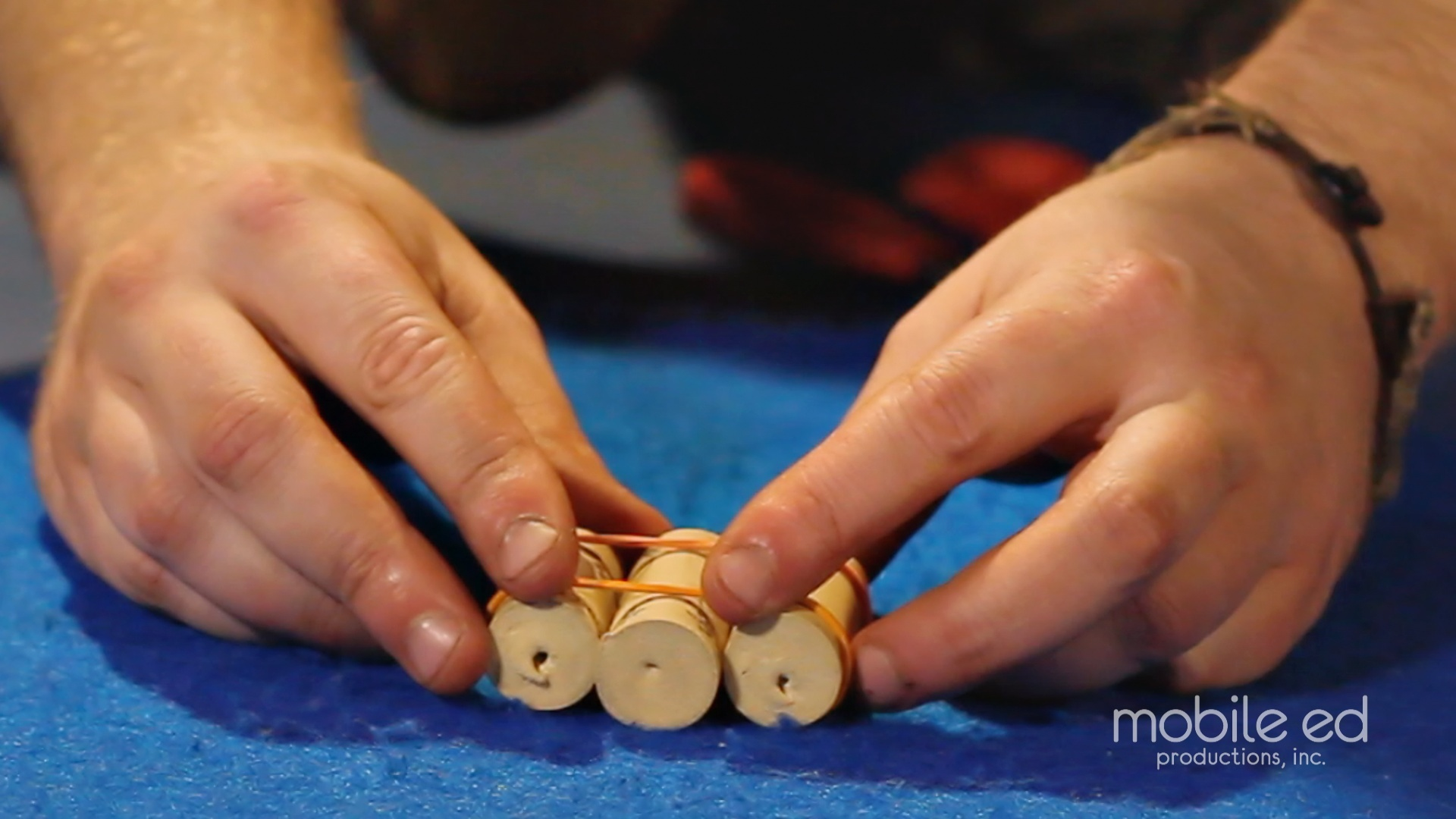 Spread the rubber bands to the ends of the corks | Handy Dan the Junkyard Man | Mobile Ed Productions