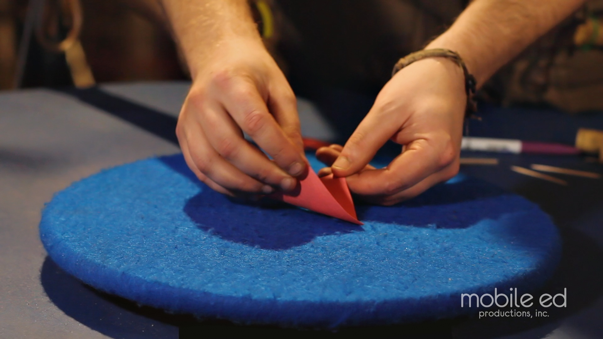 Fold the square into a triangle | Handy Dan the Junkyard Man | Mobile Ed Productions