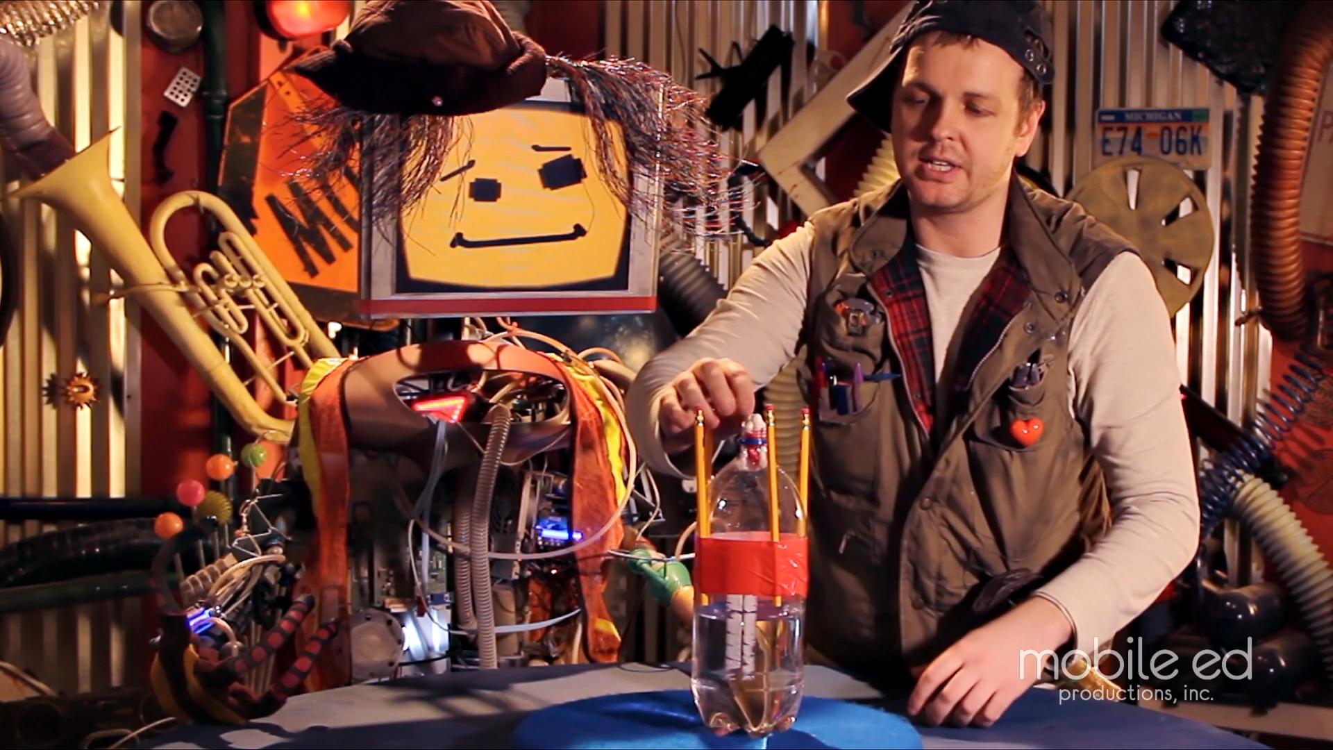Build your own rocket - position the fuel packet  |  Handy Dan the Junkyard Man