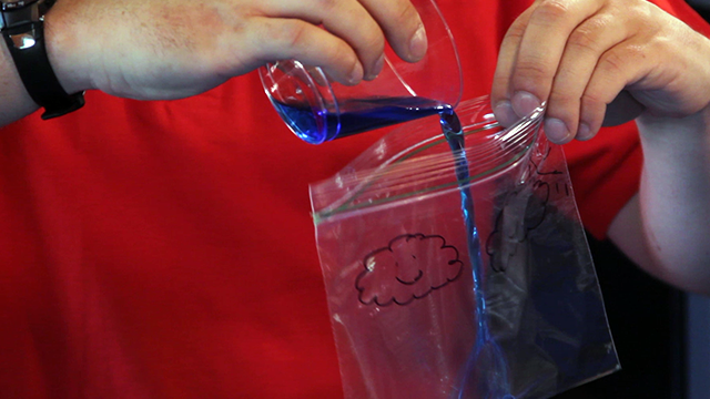 Pour colored water into your decorated bag.